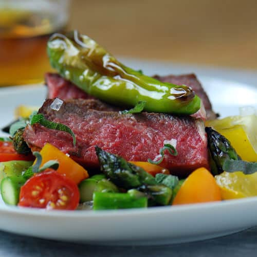 Sous vide steak shishito peppers close