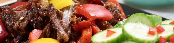 Pressure cooked pepper steak close