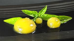 Spherified mango raviolis basil