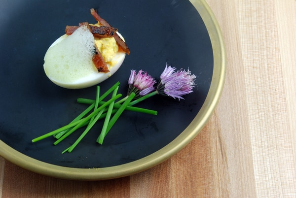 Deviled eggs candied bacon chive foam