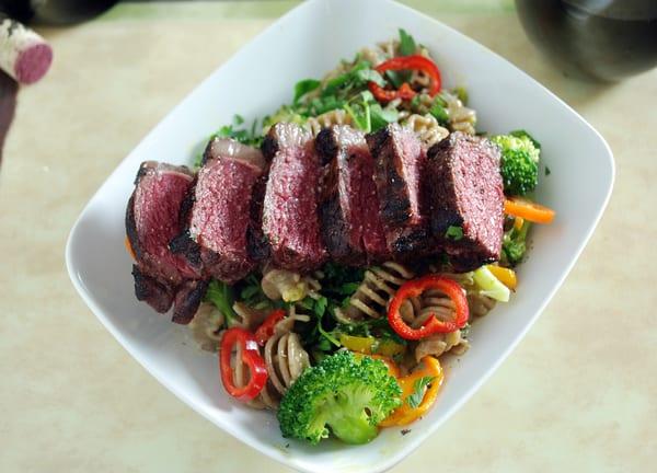Sous vide bison strip steak carbonara top