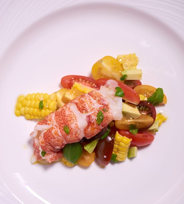 Sous vide lobster tomato salad over vert