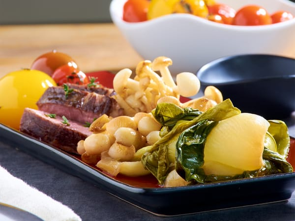 Sous vide steak with bok choy tomatoes mushrooms crop