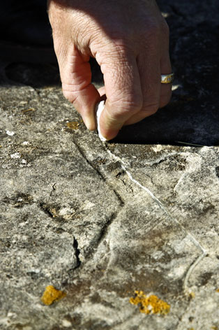 outlining a pistol carved into the rocks