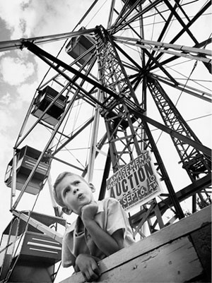 A young boy is shown at the foot of the Ferris wheel at Wedgewood, which closed in 1969.
