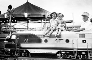 Children sit on a miniature train at Wedgewood.