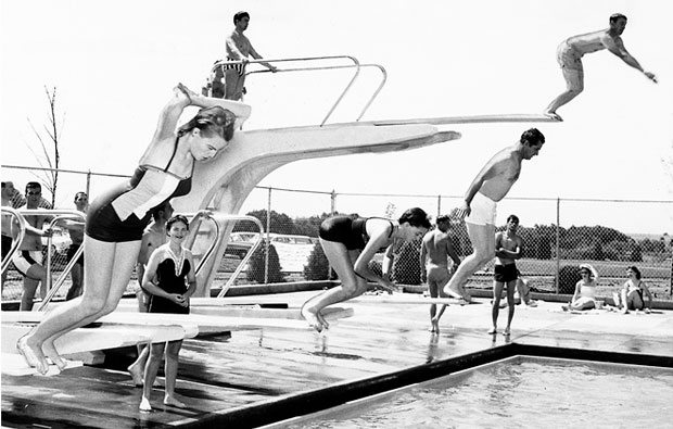 This 1958 photo shows swimmers ready to dive into the swimming pool at Wedgewood Village Amusement Park, 4500 Northwest Expressway.