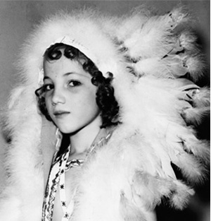 Yvonne Chouteau, 7, is shown with headdress.