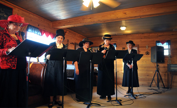 The 'Beer City Gals' re-enact the history of one of Oklahoma's rowdy pre-statehood towns. Performing in costume are, from left, Pauline Hodges (as 'Pussy Cat' Nell Jones), Earlene Schaefer, Pamela French, Virginia Frantz and Vicki Shelburne.