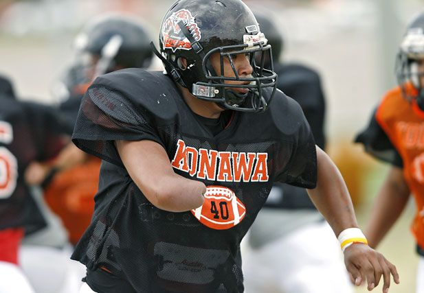 Stephen Cully runs drills with his teammates during practice at Konawa High School in Konawa, Okla., on Monday, Aug. 29, 2011.