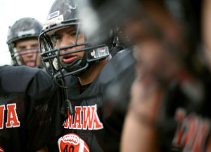 Stephen Cully and his teammates listen to instructions from a coach at Konawa High School in Konawa, Okla., on Monday, Aug. 29, 2011.