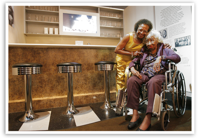 Clara Luper, seated, poses for a photo with her daughter Marilyn, in the Oklahoma History Center's display of the Katz Drug Store where the sit-in occurred 50 years ago, Tuesday, August, 19, 2008.