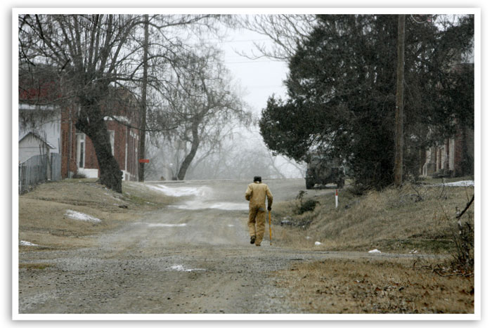 A resident walks down a quiet street in Boley in February 2007.