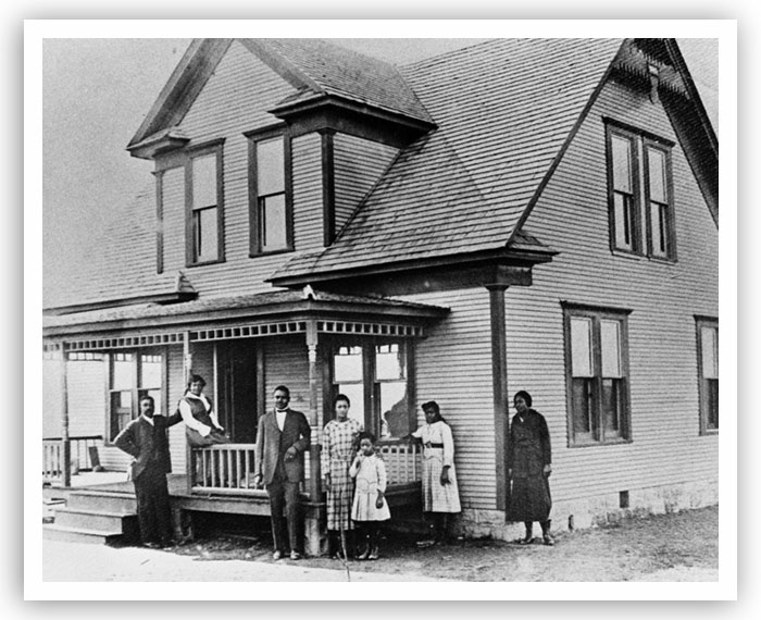 A group of people stands outside a Boley home in this undated photo.