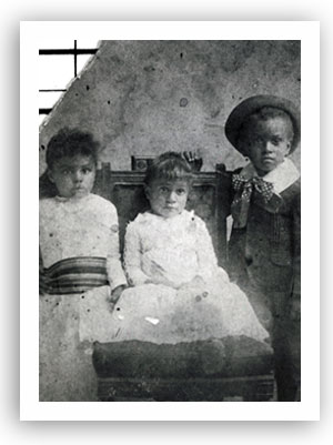 Three children - Nellie, Ollie, and William J. Matthews - in this studio portrait taken in Guthrie, Oklahoma Territory, circa 1900.