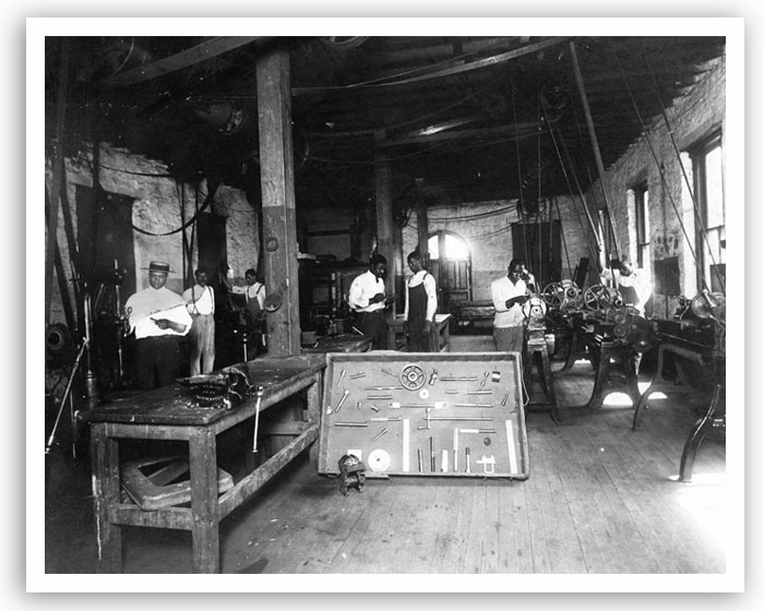 One of the early industrial shop classes at Langston University. The college started with four teachers, 41 students and 40 acres of land; within eight years, it had grown to 15 teachers, 160 acres and a main building that could hold 500 students. The university's fortunes wavered over the years, but it is now a vital school with a student population of about 4,000.
