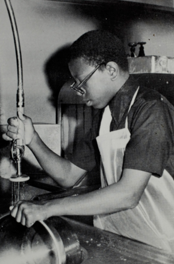 A young Currie Ballard washes dishes at Vanalog Junior High School in Compton, CA. in 1972. Ballard worked hard at school and extracurricular activities to keep out of trouble in the violence-prone south central LA neighborhoods.