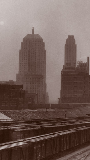This image shows the train yard and downtown Oklahoma City during a dust storm. - Staff Photo by Alphia O. Hart, 1936