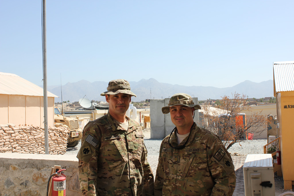 Warrant Officer 2 Todd Warrington, left, and Maj. Casey Reed are part of the Oklahoma Army National Guard's 45th Infantry Brigade Combat Team in Afghanistan. Warrington's son Dakota is a Mustang junior receiver/defensive back, and Reed's son Berkeley is Edmond North's junior deep snapper.