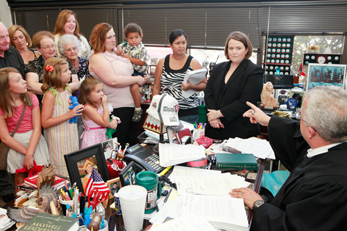 Judge Kirby performs the Adoption Ceremony for Darlin' and Biggin' and mother Michelle Kelley, Thursday, July 28, 2011. The children were in foster care for several years and are now being adopted by the single mother at the Oklahoma County Juvenile Justice Center, 5905 Classen Boulevard, in Judge Kirby's chambers.