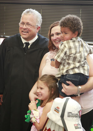 Judge Kirby poses for a photo with Michelle Kelley and her adopted children Darlin' and Biggin' after their Adoption Ceremony, Thursday, July 28, 2011. The children were in foster care for several years and are now being adopted by the single mother at the Oklahoma County Juvenile Justice Center, 5905 Classen Boulevard, in Judge Kirby's chambers.