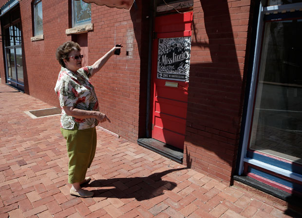 Maxine Pruitt, Guthrie's municipal service director, stands outside the door to Miss Lizzie's.
