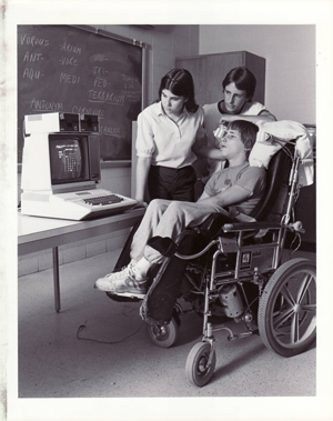 Rick Hoyt as a young man learning to use his first computer
