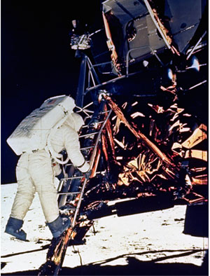 Buzz Aldrin descend steps of the Lunar Module ladder as he prepares to walk on the surface of the moon