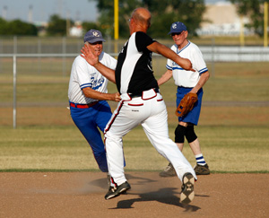 Ray Rowland tries to tag an opposing player at the Plex Sports Complex in Oklahoma City, July 5, 2011.