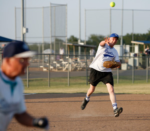 73-year-old Fred Jones (1) throws a ball from third base during a game at the Plex Sports Complex in Oklahoma City, July 5, 2011.
