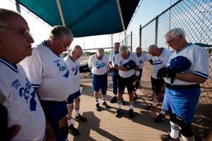 The Oklahoma City Royals softball team prays before a game July 5, 2011.