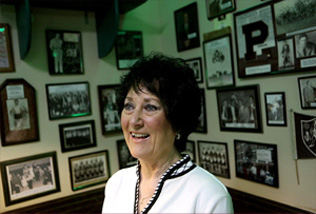 Marilee Macias and her husband Tony, a former Perry and OU wrestler, have owned the Kumback Lunch since 1973. The restaurant's walls are covered with Perry wrestling photos and it serves as an unofficial hub for the town.