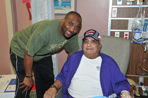 Former OU safety Roy Williams visits a VA hospital as part of Pros for Vets. Reggie Whitten spearheaded the drug-awareness program for military veterans, in large part because his father was a vet.