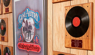 Original 78 rpm recprds of some of Gene Autry's most famous western songs.