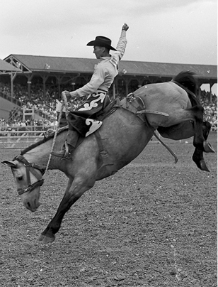 Freckles Brown rides Hell To Set during a July 29, 1961, rodeo in Cheyenne, Wyo.