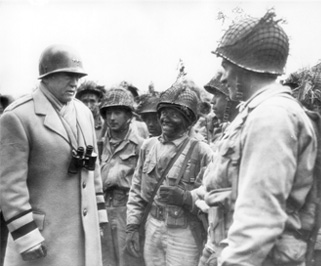 Gen. George S. Patton, known as Old Blood and Guts by many who served under him, inspects American troops in Britain during the war. Guido Ferlo's tank group was under the command of Patton during the war.