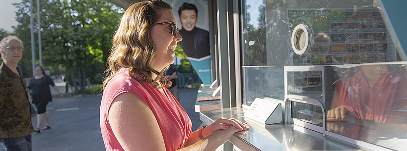 Customer buying tickets at Ravinia Box Office window