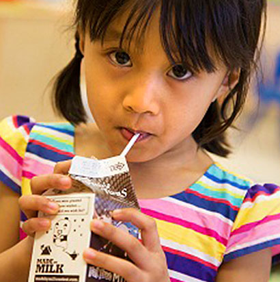 girl drinking chocolate milk