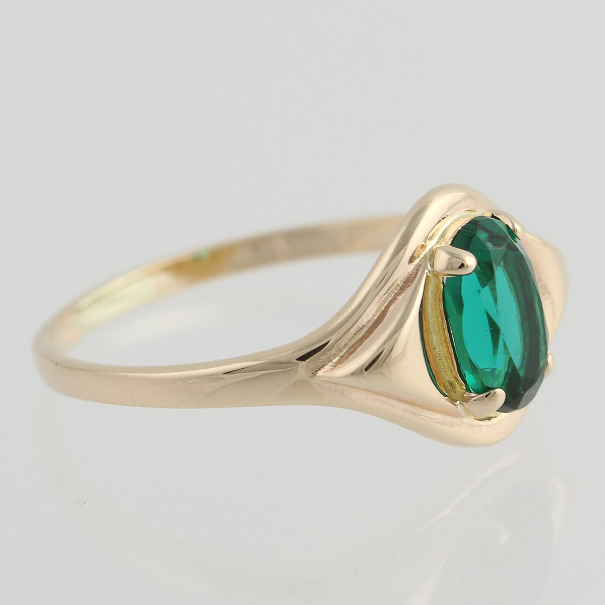 small simulated emerald ring 10k yellow gold oval glass