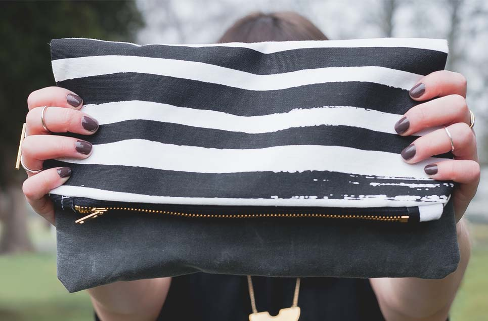 black stripe clutch