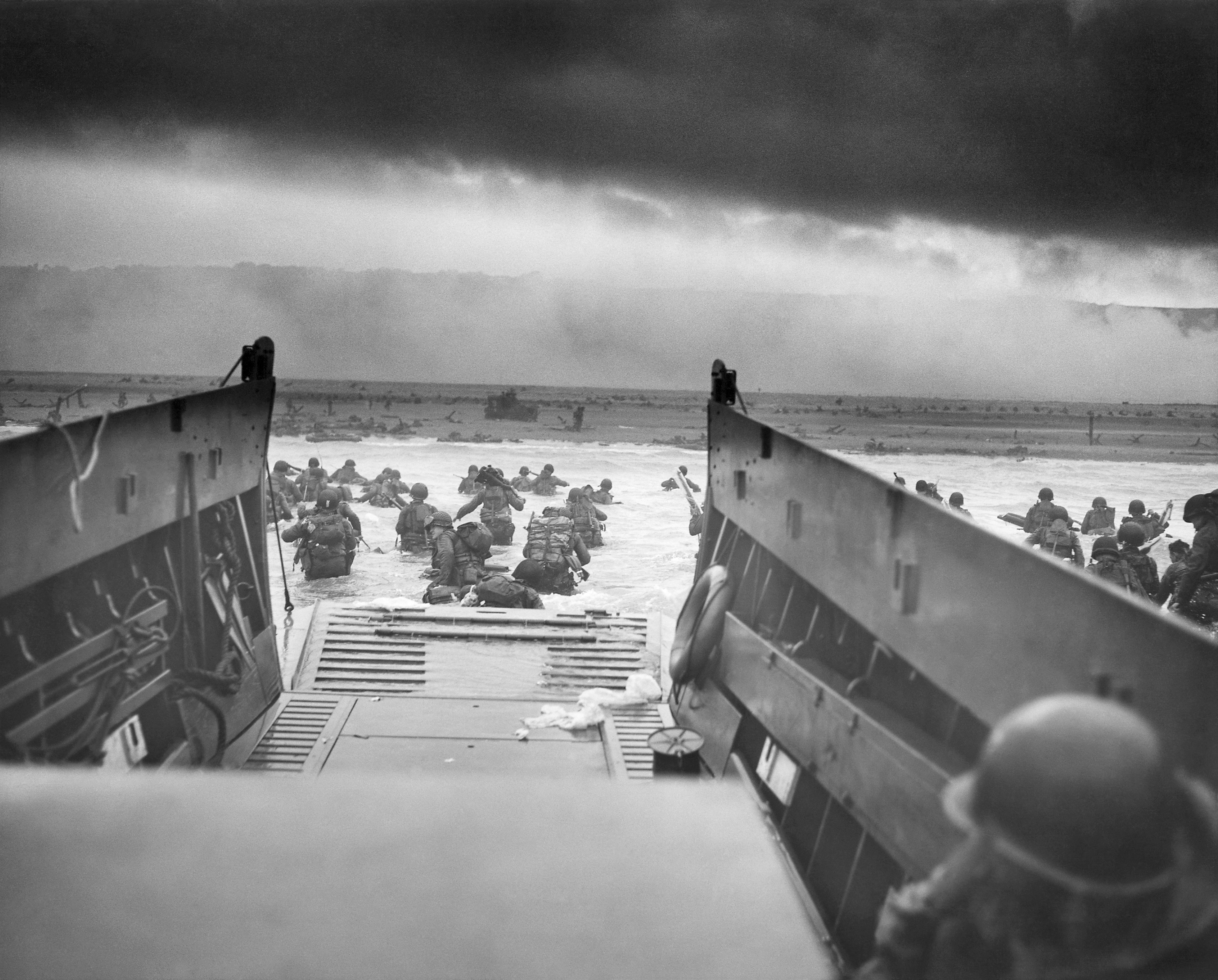 Original B&W photo of soldiers in the 16th Infantry Regiment, 1st Infantry  Division landing at Omaha Beach on June 6, 1944