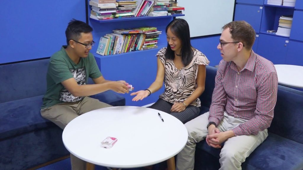 Huy Doan student performs magic with cards