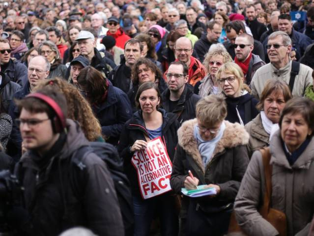 A woman with a poster attends with thousands of other demonstrators the March for Science in Berlin, April 22, 2017. Markus Schreiber/AP Photo