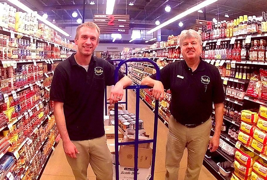 Photo of two employees filling shelves.