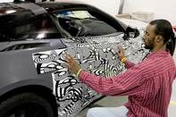 """Zebra tape"" camouflage was applied to the test cars before they saw the light of day; the graphic treatment is carefully designed to hide styling elements."