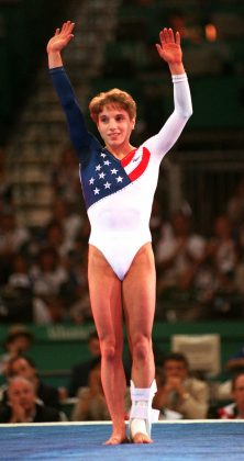 United States' gymnast Kerri Strug waves to the spectators during the Gymnastics Gala at the Centennial Summer Olympics Games in Atlanta, Tuesday, July 30, 1996. (AP Photo/Lynne Sladky)