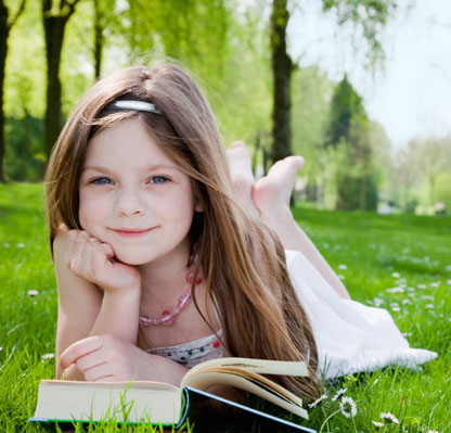 little-girl-reading-book-outside