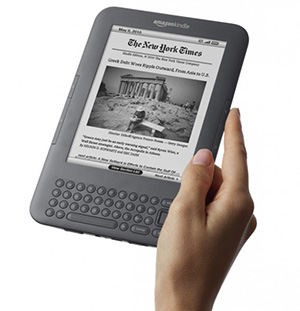 Hand holding a Kindle 3