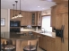 In this segment, we'll check out a uniques custom cabinetry job that involves a complete remodel and removing a wall.