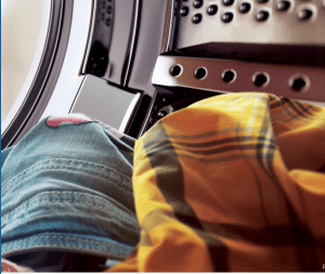 Shirt and jeans in dryer